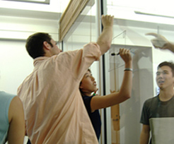 Mayfield Fellows working on a glass board at Stanford